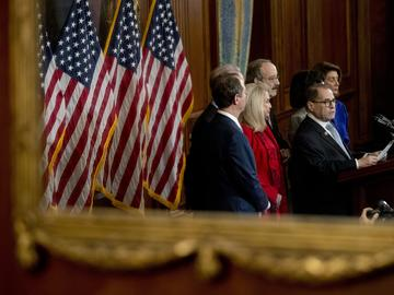 As seen in reflection, Chairman of the House Committee on the Judiciary Jerrold Nadler, D-N.Y. and other House Democratic leaders unveil articles of impeachment against President Trump, Dec. 10