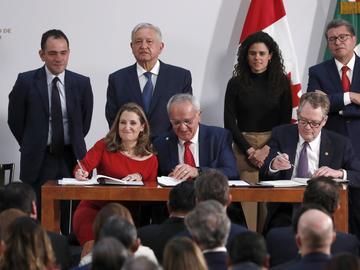 Deputy Prime Minister of Canada Chrystia Freeland, left, Mexico's top trade negotiator Jesus Seade, center, and U.S. Trade Representative Robert Lighthizer, sign an update to NAFTA.