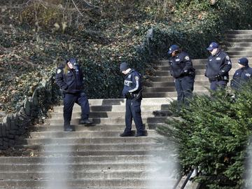 Law enforcement officers search Morningside Park, Thursday, Dec. 12, 2019. An 18-year-old Barnard College freshman, identified as Tessa Majors, was fatally stabbed during an armed robbery in the park.
