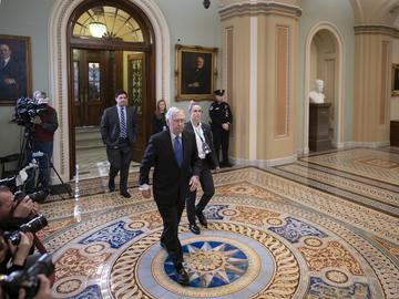 Senate Majority Leader Mitch McConnell, R-Ky., leaves the chamber during a short break in the impeachment trial of President Donald Trump on charges of abuse of power and obstruction of Congress.