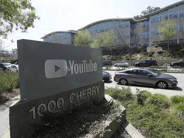 A YouTube sign is shown across the street from the company's offices in San Bruno, Calif., Tuesday, April 3, 2018.