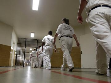 In this, Monday, Sept. 23, 2013, file photo, inmates walk the halls in formation at Tutwiler Prison for Women in Wetumpka, Ala.