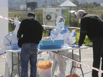 People quarantined with Corona virus arrive to vote at a specially made tent in Haifa, Israel, Monday, March 2, 2020.