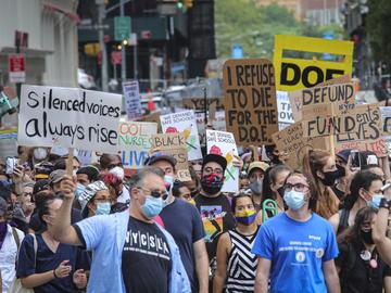 A coalition of teachers, students, and families protest during a rally called National Day of Resistance Against Unsafe School Reopening Opening, Monday, Aug. 3, 2020, in New York.