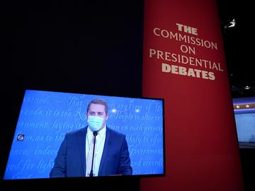 A television monitor shows a stand-in during rehearsal tests ahead of the final presidential debate between Republican candidate President Donald Trump and Democratic candidate former VP Biden.