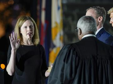 President Donald Trump watches as Supreme Court Justice Clarence Thomas administers the Constitutional Oath to Amy Coney Barrett on the South Lawn of the White House White House in Washington.