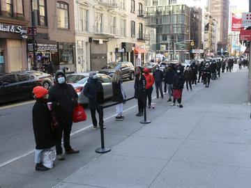 People line up outside a CityMD urgent care clinic offering COVID-19 testing in the borough of Manhattan in New York City on Thursday, November 19, 2020.
