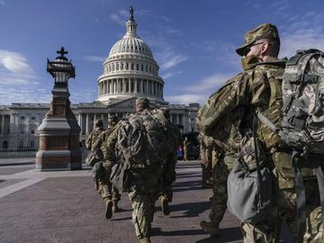 National Guard troops reinforce security around the U.S. Capitol ahead of expected protests leading up to President-elect Joe Biden's inauguration, in Washington, Sunday, Jan. 17, 2021.