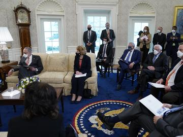 In this Feb. 3, 2021, file photo President Joe Biden and Vice President Kamala Harris meet with Senate Majority Leader Sen. Chuck Schumer of N.Y., left, and other Democratic lawmakers to discuss...