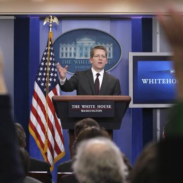 White House Press Secretary Jay Carney gestures during his daily news briefing at the White House in Washington, Wednesday, Feb. 16, 2011.