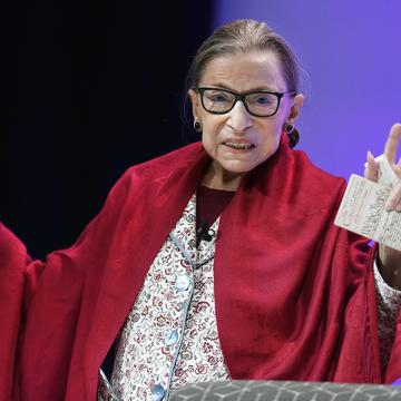 U.S. Supreme Court Justice Ruth Bader Ginsburg gestures to students before she speaks at Amherst College in Amherst, Mass., Thursday, Oct. 3, 2019.
