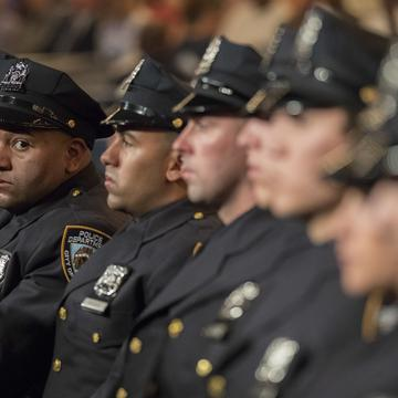 The newest members of the New York City police listen to the speakers during their graduation ceremony, Thursday, June 29, 2017, in New York.