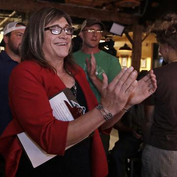 Vermont Democratic gubernatorial candidate Christine Hallquist, a transgender woman and former electric company executive, applauds with her supporters during her election night party in Burlington.