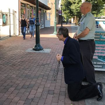 A commercial strip in Brentwood, Long Island where two men pray in front of a female health clinic.
