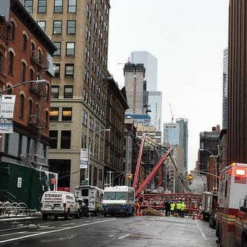 A crane in Lower Manhattan collapsed early Friday morning killing one person and injuring at least two others. Workers were securing the crane when it toppled over, smashing several cars on the block.