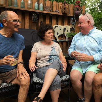 Neighbors gather in a backyard in West Orange, N.J., to talk politics.
