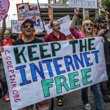 activists with Keep the Internet Free sign