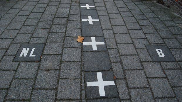 Netherlands/Belgium border painted on the sidewalk in Baarle-Nassau.