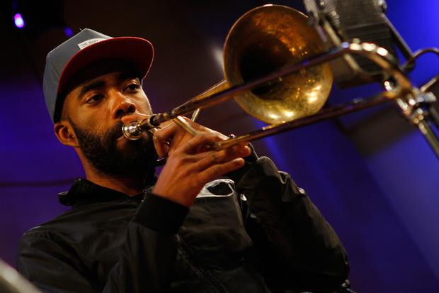 Corey King playing trombone with Jose James at WNYC.