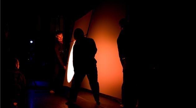 Pilobolus pours light to create a sun on the stage.