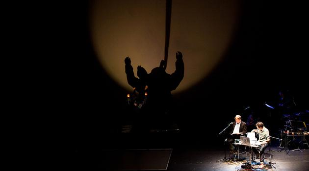 Pilobolus makes a shadow astronaut as Dave Wolf describes the contrast between light and dark in outer space.