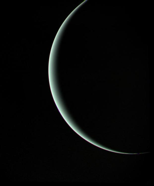 Farewell shot of crescent Uranus as Voyager 2 departs. January 25, 1986. Range 600,000 miles.