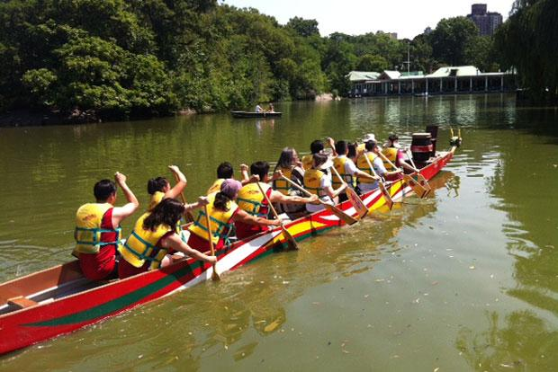 Leaders from New York's Asian community make their way around the lake in a dragon boat.