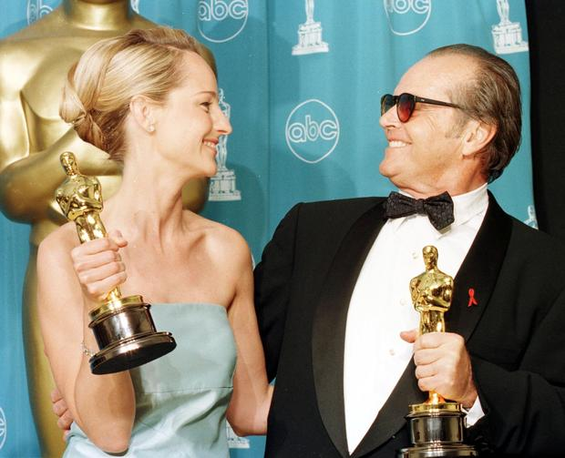 Actress Helen Hunt (L) and actor Jack Nicholson (R) look at each other after winning Best Actress and Best Actor Oscars for their roles in 'As Good As It Gets' at the 70th Annual Academy Awards