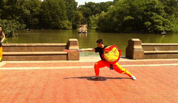 A Shaolin martial artist wields a sword during his performance.