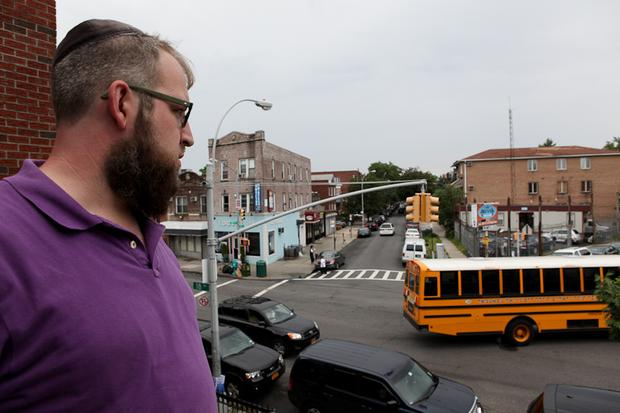 Asher Steinmetz, 36, looks out near the site where Leiby Kletzky was last seen in Borough Park, Brooklyn. Cameras across the street recored footage of him and Aron.