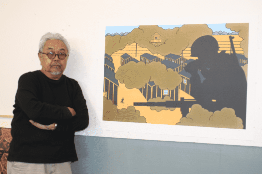 Shimomura stands next to his color lithograph,
