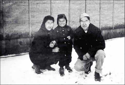 Roger Shimomura as a toddler with his mother and father.
