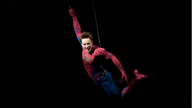 Spoiier Alert: An unmasked Spider-Man, played by Reeve Carney, soars through the air in triumph during the last scene of the musical.