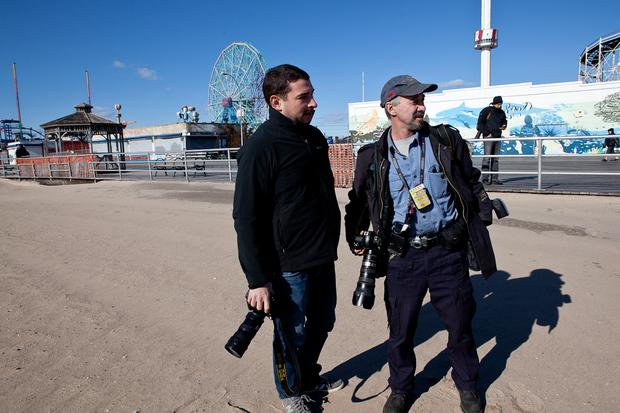 Daily News photographers Joe Marino (L) and Todd Maisel (R) at Coney Island looking into a DOA at Coney Island.