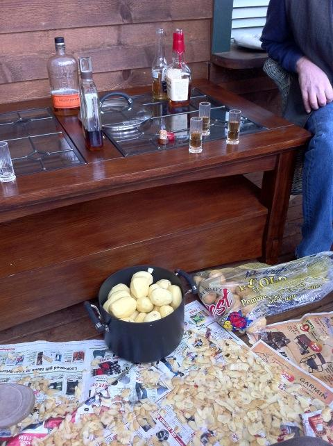 Whiskey and peeling potatoes. A Thanksgiving tradition