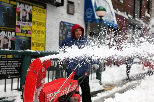 Snow blower making it's way down street in SoHo