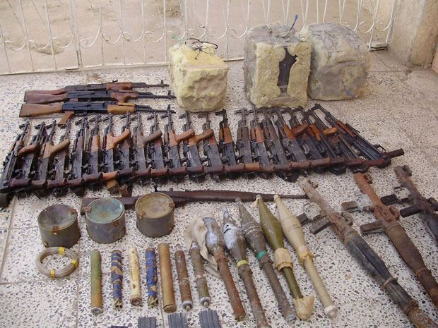 Wilkens took this shot of a cache of munitions his squad discovered during his second deployment in Iraq in the backyard of a house.