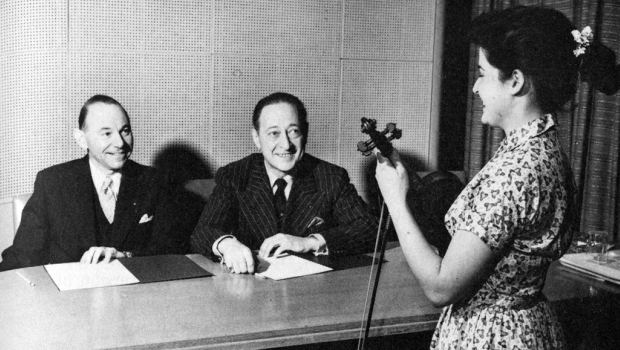 Many of classical music's biggest stars came to the WQXR studios throughout the 1940s and '50s, including Jascha Heifetz (right), seen here sitting next to WQXR music director Abram Chasins.