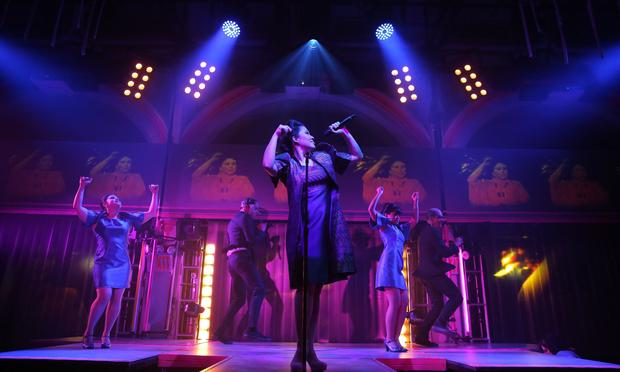 Ruthie Ann Miles (center) and the cast of Here Lies Love