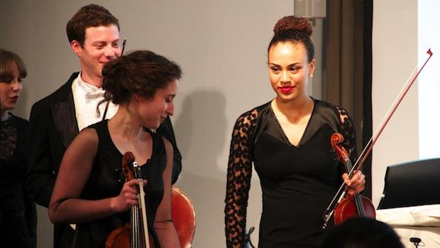 Musicians from the Mannes College of Music model new orchestra garments at the Parsons School