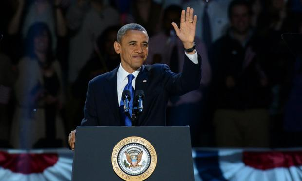 US President Barack Obama arrive on stage after winning the 2012 US presidential election November 7, 2012 in Chicago, Illinois.