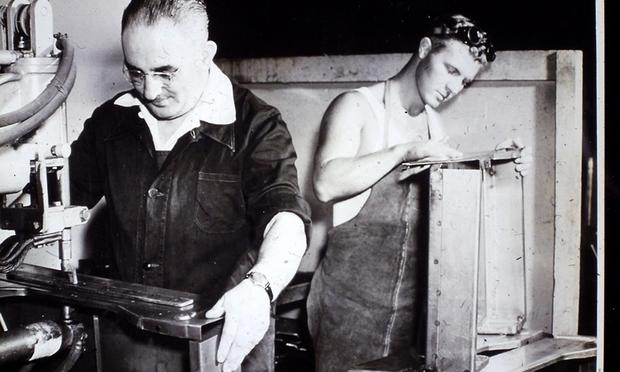 Charles Bliss working in a factory