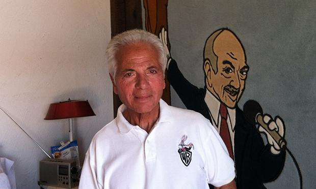 Noel Blanc in front of a mural of his dad, Mel Blanc