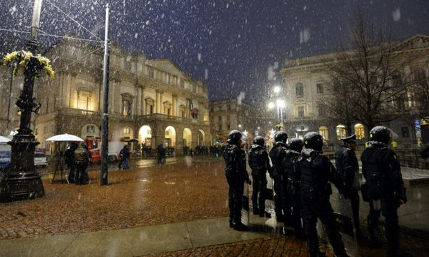 Riot policemen stand as guests arrive for the opening show of the season of La Scala opera house on Dec. 7, 2012 in Milan
