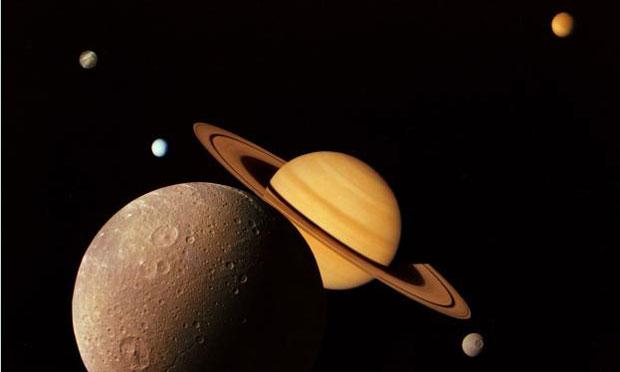 A montage of images of the Saturnian system prepared from an assemblage of images taken by the Voyager 1 spacecraft during its Saturn encounter in November 1980.