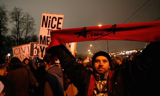 A protester stands in Bolotnaya Square on December 10, 2011 in Moscow, Russia. Protests took place in Moscow and St. Petersburg this wee