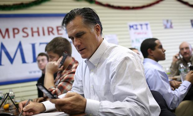 Republican presidential candidate, former Massachusetts Gov. Mitt Romney makes calls to likely voters at his New Hampshire campaign headquarters on January 9