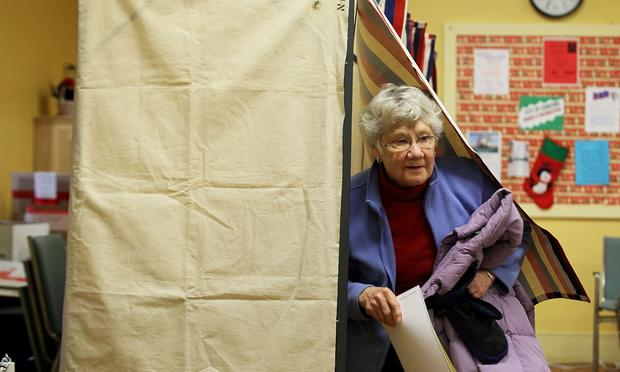 Local voter Julie Runnells comes out from a voting booth at a polling station January 10, 2012 in Concord, New Hampshire