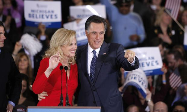 Republican presidential candidate and former Massachussetts Gov. Mitt Romney (R) and his wife Ann wave to supporters at a primary night gathering at the Suburban Collections Showplace on February 28,