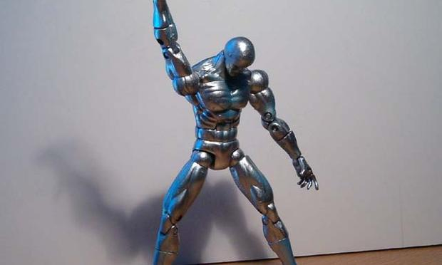 silver action figure doing dance from Saturday Night Fever